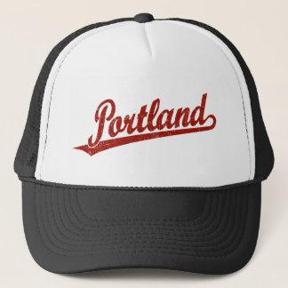 Portland script logo in red distressed trucker hat