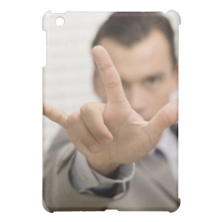 Portrait of a businessman making a hand sign case for the iPad mini