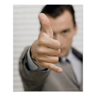 Portrait of a businessman making a thumbs up poster