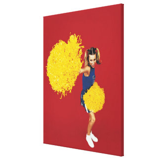 Portrait of a Cheerleader Holding Pom-poms Canvas Print