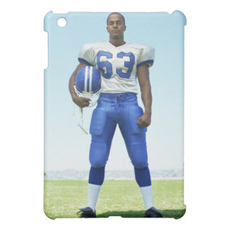 portrait of a football player holding a football iPad mini cover