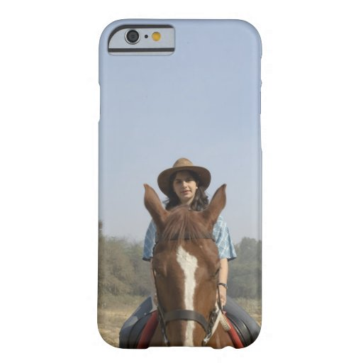 Portrait of a teenage girl riding a horse iPhone 6 case