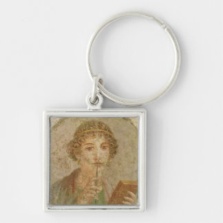 Portrait of a young girl key chain