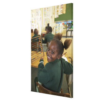 Portrait of a young schoolgirl smiling, KwaZulu Canvas Prints