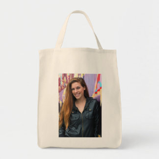 Portrait of a young woman canvas bags