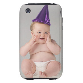 Portrait of baby wearing purple party hat and tough iPhone 3 covers