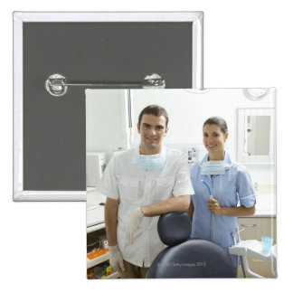 Portrait of dentist and his assistant in a button