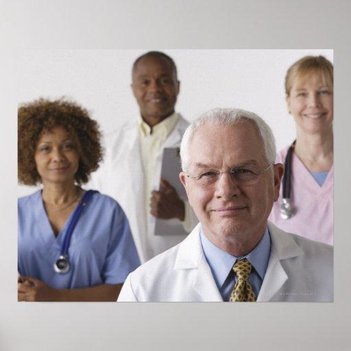 Portrait of four medical professionals, studio print