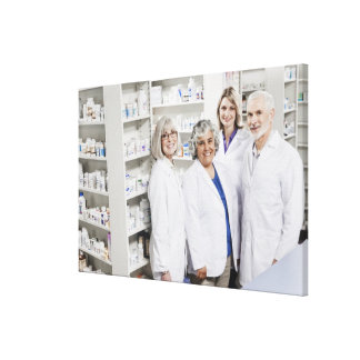 Portrait of four smiling pharmacists canvas prints