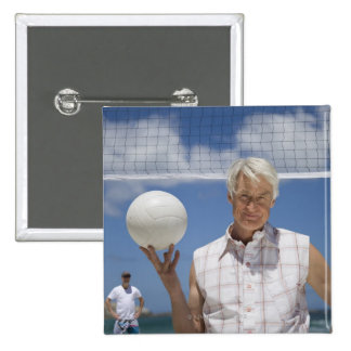 Portrait of mature man holding volley ball on 15 cm square badge