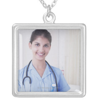 Portrait of nurse in hospital silver plated necklace