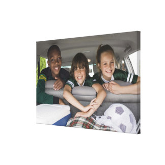 Portrait of smiling children in car gallery wrap canvas