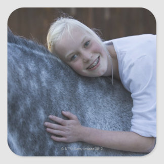 portrait of young girl on white horse square sticker