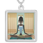 Portrait of young woman doing yoga square pendant necklace