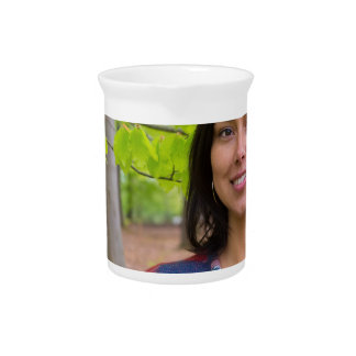 Portrait woman with green leaves in spring pitcher