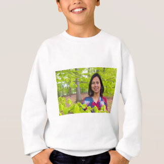 Portrait woman with green leaves in spring sweatshirt