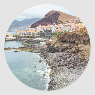 Portuguese coast with sea beach mountains village classic round sticker