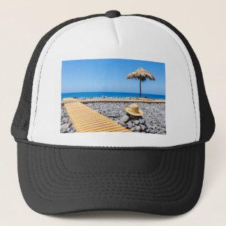 Portuguese stony beach with path sea hat parasols
