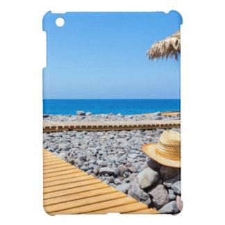 Portuguese stony beach with path sea hat parasols iPad mini cover