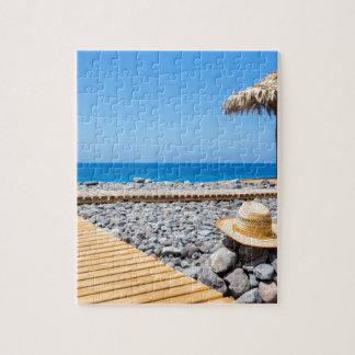 Portuguese stony beach with path sea hat parasols jigsaw puzzle