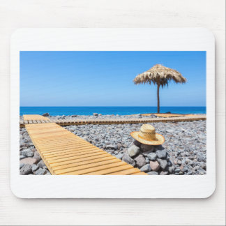 Portuguese stony beach with path sea hat parasols mouse pad