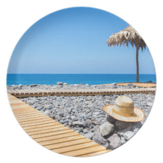 Portuguese stony beach with path sea hat parasols plate