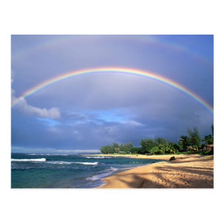 postcard with a beautiful seashore rainbow