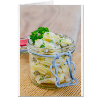 Potato salad in a jar on wooden card