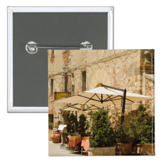 Potted plants and patio umbrellas in front of a button