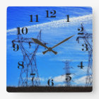 Power lines in blue sky square wall clock