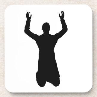 Praying man on the knees coaster