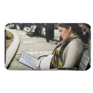 Pregnant Middle Eastern woman reading on park iPod Case-Mate Cases