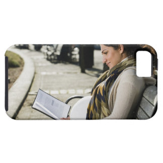 Pregnant Middle Eastern woman reading on park Tough iPhone 5 Case