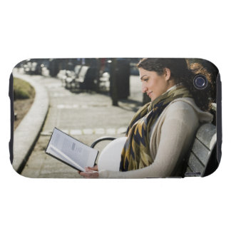 Pregnant Middle Eastern woman reading on park iPhone 3 Tough Case