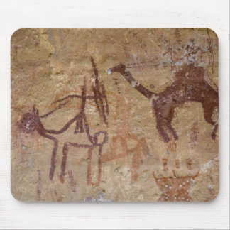 Prehistoric rock paintings with camels and mouse pad