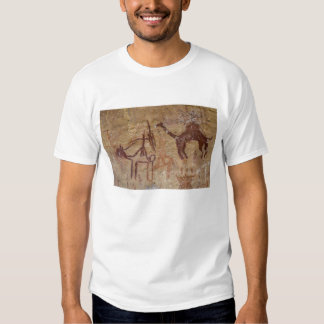 Prehistoric rock paintings with camels and tee shirts