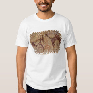 Prehistoric rock paintings with camels and tshirt