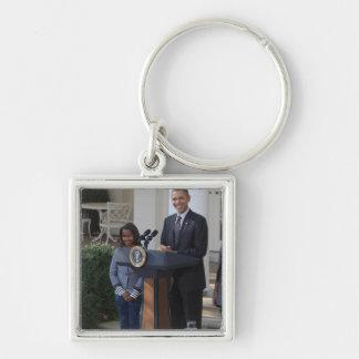President Barack Obama pardons the Silver-Colored Square Key Ring