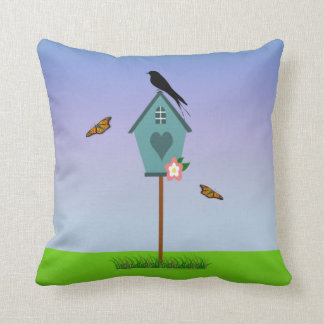 Pretty Bird Silhouette on top a Blue Birdhouse Cushion
