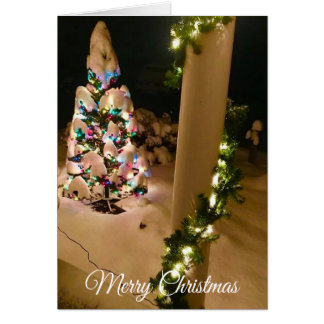 Pretty Lit up Christmas Tree Covered in Snow Card