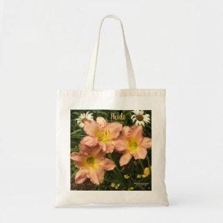 Pretty peach trio of daylilies tote bag