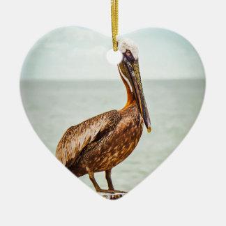 Pretty Pelican Perched Over the Ocean Ceramic Ornament