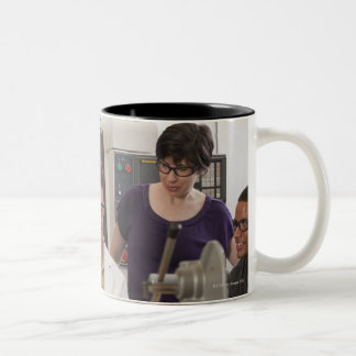 Professor demonstrating the tool holder from the Two-Tone mug