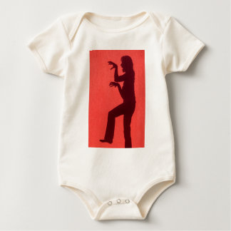 Profile shadow of woman on red wall baby bodysuit