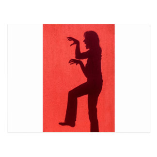Profile shadow of woman on red wall postcard