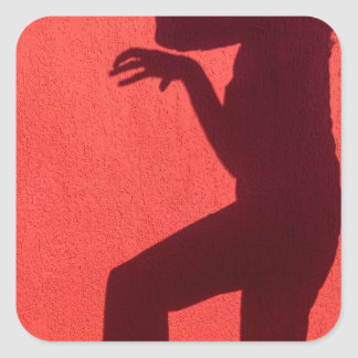 Profile shadow of woman on red wall square sticker