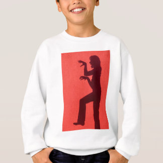Profile shadow of woman on red wall sweatshirt