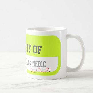 PROPERTY OF ONE HARDWORKING MEDIC Yellow Mug