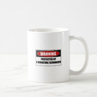 Protected By A Miniature Schnauzer Coffee Mug