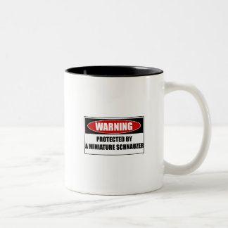 Protected By A Miniature Schnauzer Two-Tone Coffee Mug